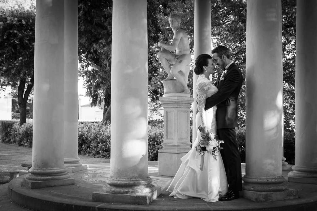 The groom and the bride exchange a romantic kiss