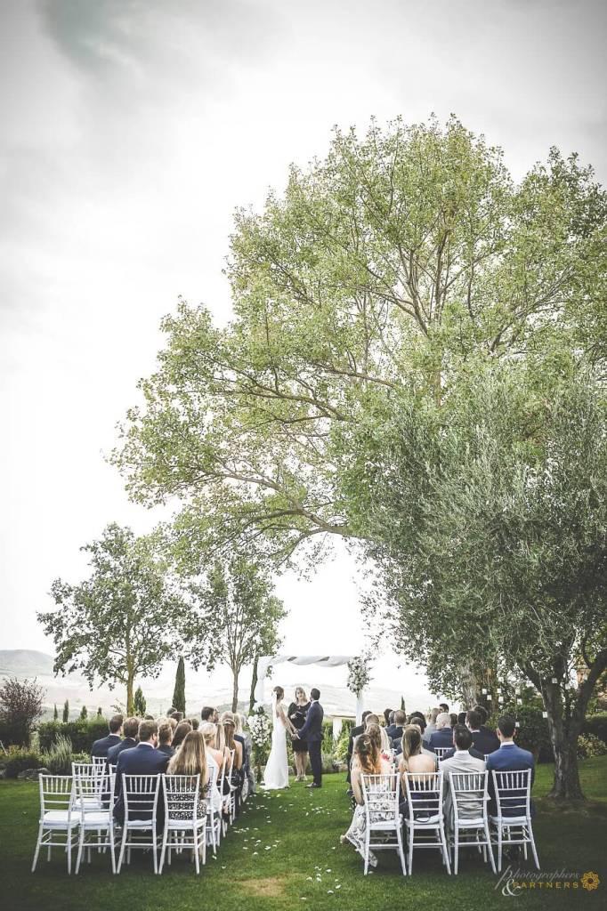 Bride and groom at wedding ceremony listen to registrar speech