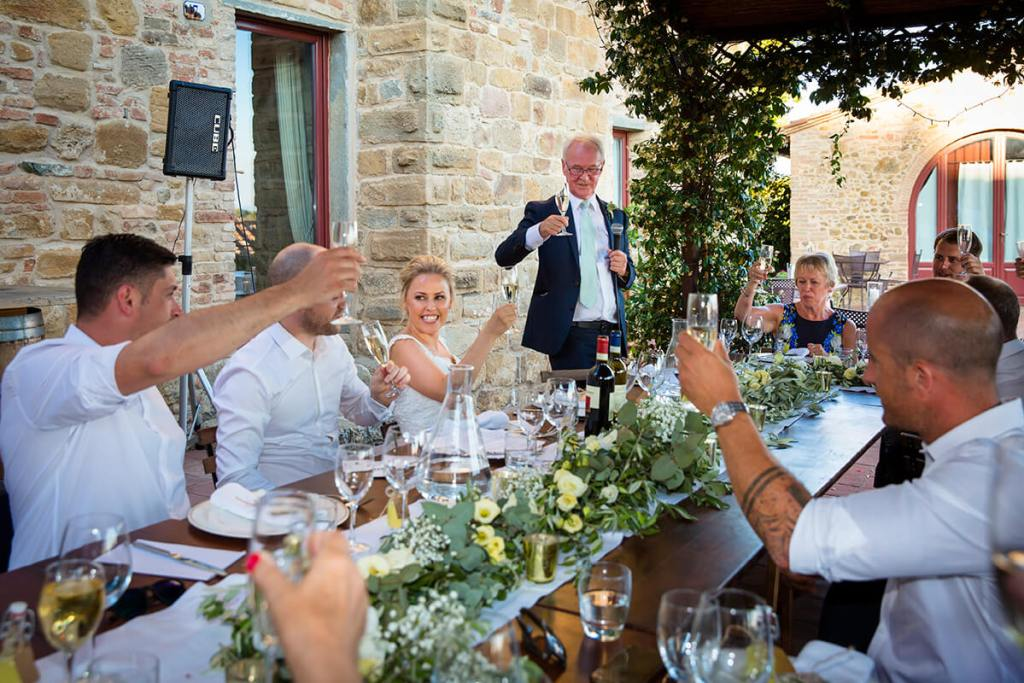 The bride's father reads a speech for the guests