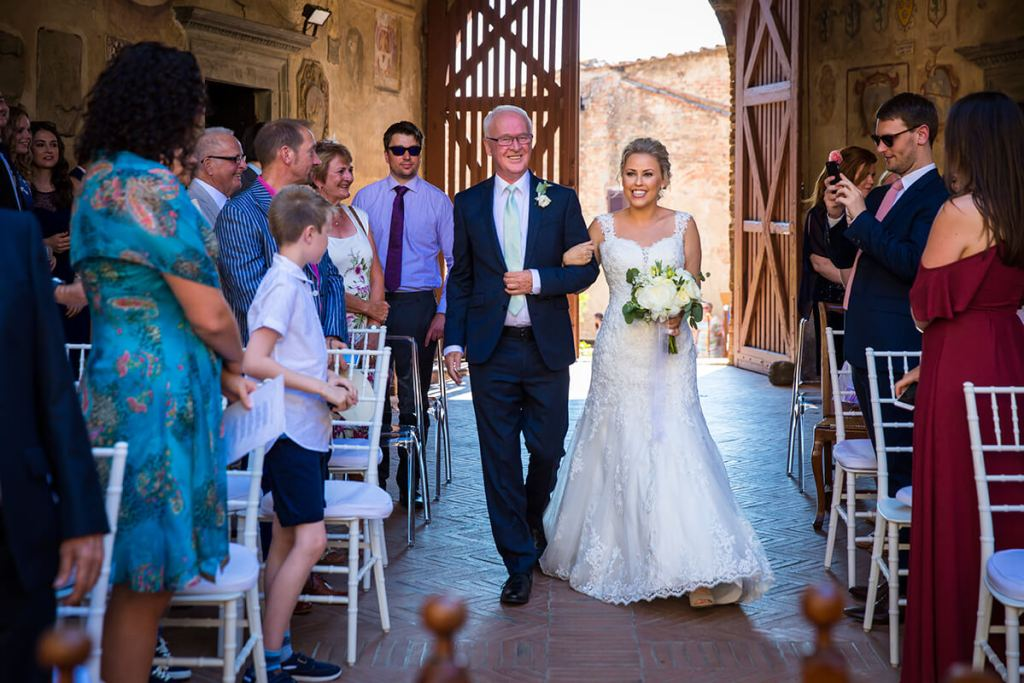 The bride arrives to the location of the ceremony with her father