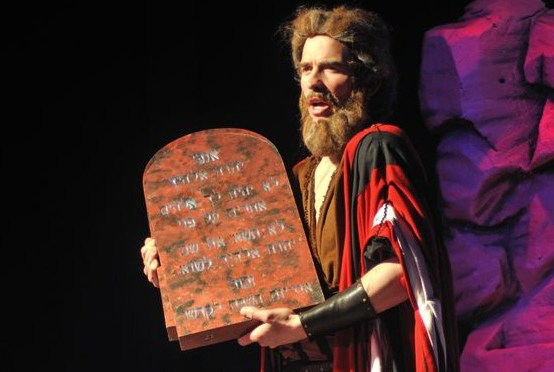 18872193 - moses with the ten commandments in a biblical stage performance