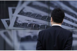 man-looking-at-money