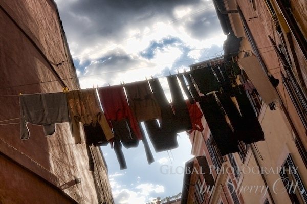clothes hang on a line in Italy
