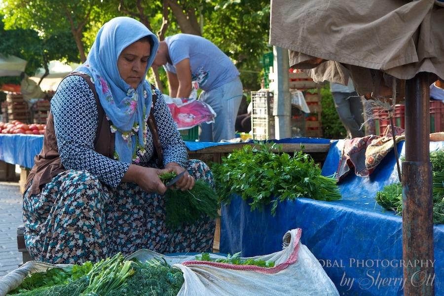 A woman prepares produce