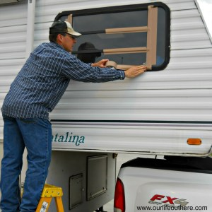 Farm guy duct taping the rv window