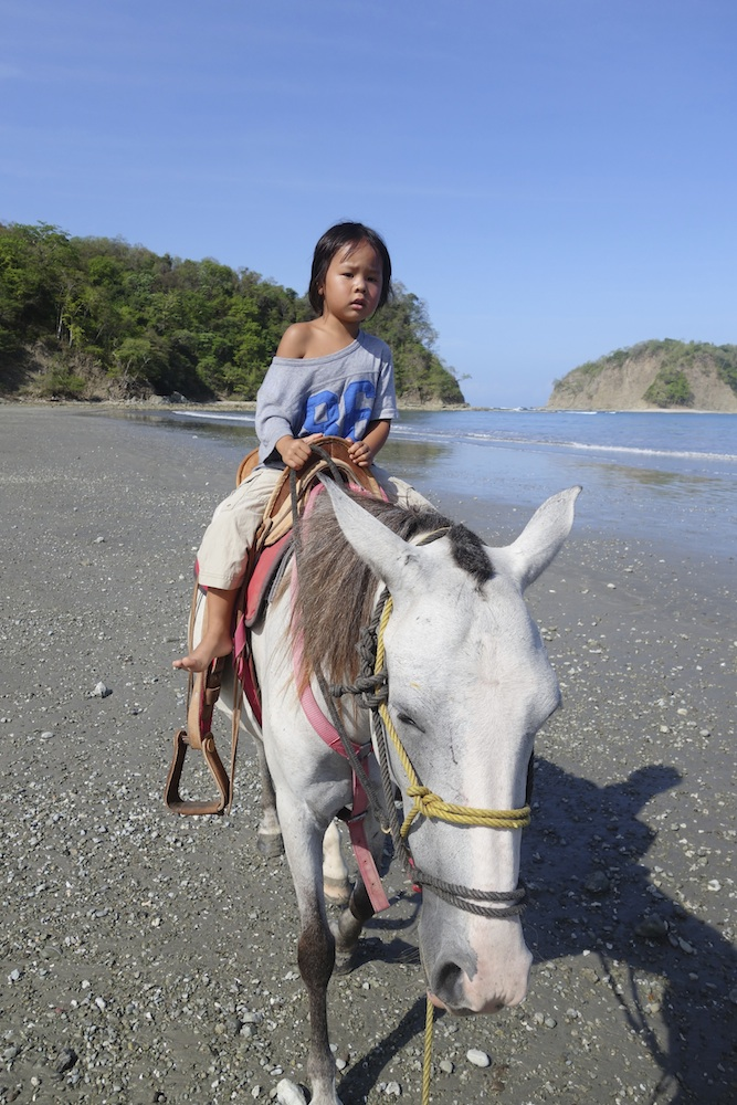 First time on a horse by himself. Sámara beach of Costa Rica.