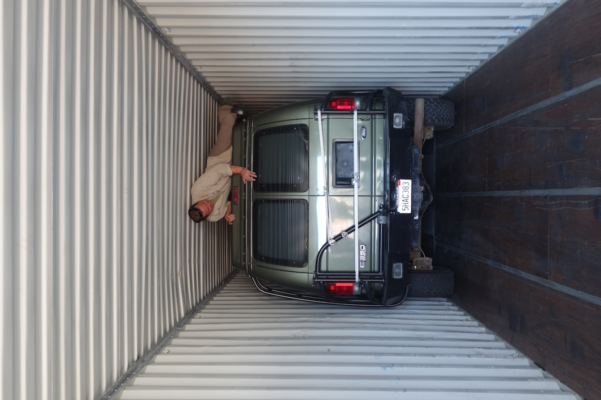 We loaded the van in a shipping container. There is maybe 5 inches in total to spare in width, and Simon had to climb out the window over the top to come out.