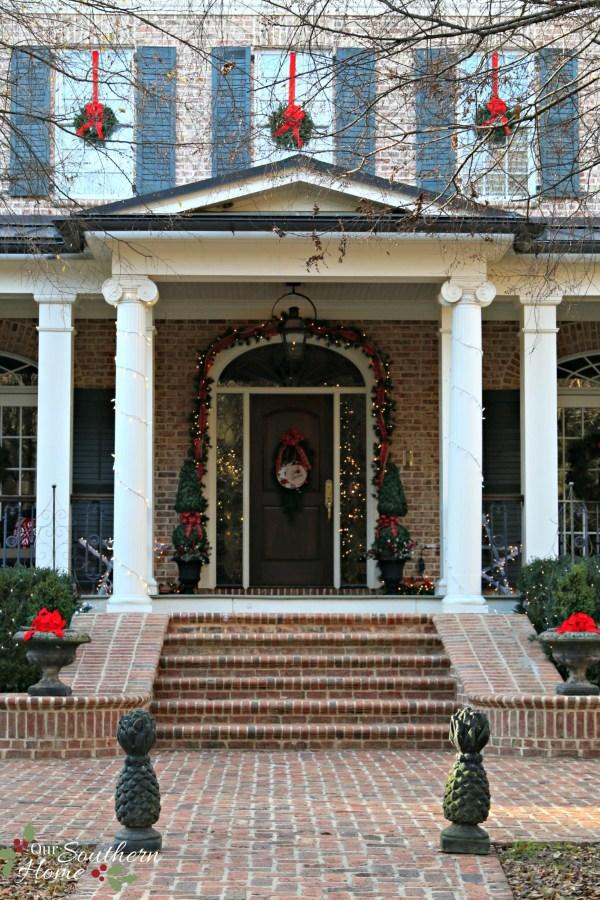 christmas porch entrance / Christmas Front Porch / www.oursouthernhomesc.com