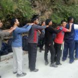 Group shoulder massage at rest point while trekking to Tekhla rock area