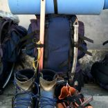 Packed rucksack and shoes