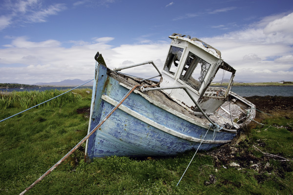 A simple photo of a boat, with some lines to draw the viewer to the center of interest, and interesting colors and textures to hold the viewers' interest.