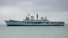 Former HMS Ark Royal under tow from Portsmouth Harbour to the scrapyard