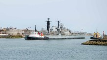 Former HMS Edinburgh leaving passing the Round Tower, Southsea on its way to the scrapyard