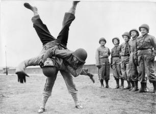 """American army nurse during WW2  demonstrating Ju-Jitsu, the """"gentle technique"""". This Japanese martial art uses the opponent;s own strength against herself,"""