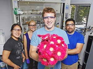 From left: Jenny Du, Kelsey Mollick, James Rogers and Louis Perez of Apeel Sciences, a UC Santa Barbara spinout that makes an edible, sprayable plant compound that can be applied to produce and flowers to keep them fresh longer. (Stephen Nellis / Business Times photo)