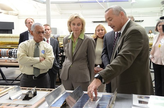 Deployable Space Systems President Brian Spence, right, shows NASA Administrator Charles Bolden, left, and Congresswoman Lois Capps how different solar cell arrangements can increase yields at a tour of the company's headquarters in Goleta on June 1. (Austen Hufford / Business Times photo)