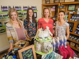 The Grapeseed Co. team, from left, media and catalog designer Julia Marsh, manager Bre Wright, owner Kristin Fraser and sales and manufacturing assistant Silvia Corral.