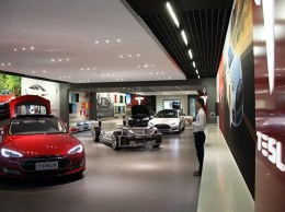 A Tesla Motors Model S electric vehicle stands on display at the company's showroom in Beijing, China. (Bloomberg News photo)
