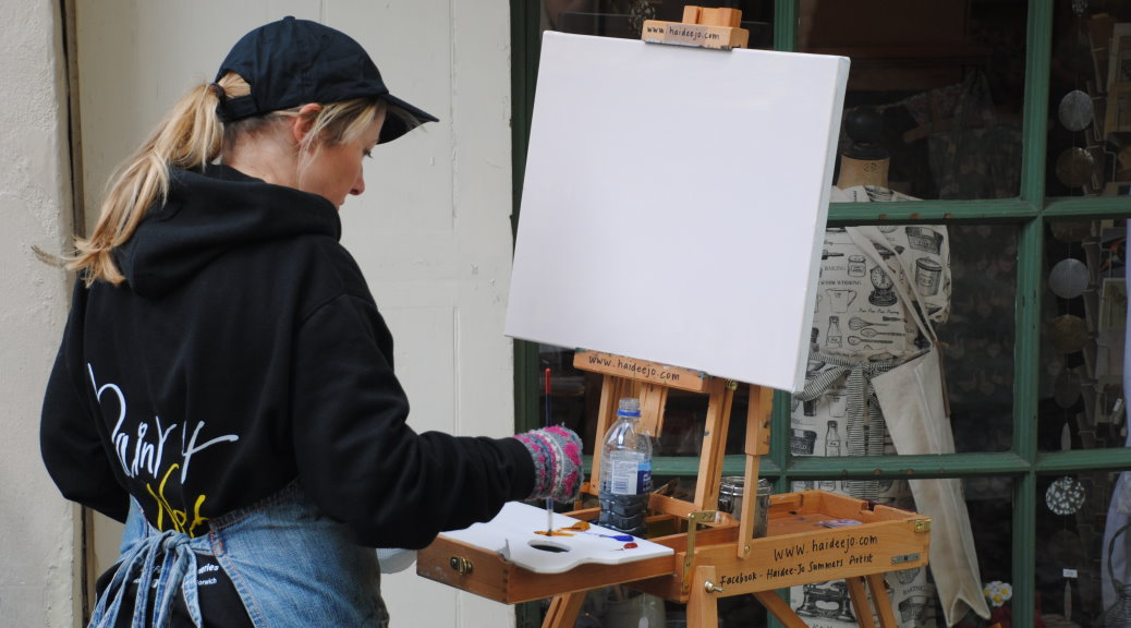 Haidee-Jo Summers painting the winning painting at Paint Out Norwich 2014