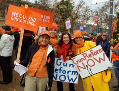 Palo Alto residents took to the streets (well, University Ave) to advocate for gun control. Photo by Nana Chancellor