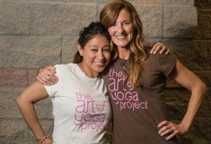 Mary Lynn Fitton, the founder of the Art of Yoga Project, with Rocsana Enriquez, who went through the program as a teen