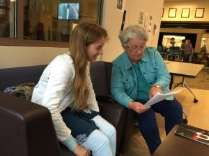 An AAR mentor meets with one of her Palo Alto students to review progress