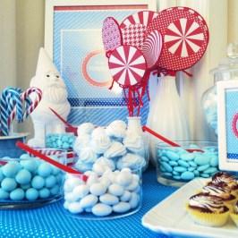 allestimento buffet festa battesimo natalizio rosso e blu con confetti e dolci di paola maresca