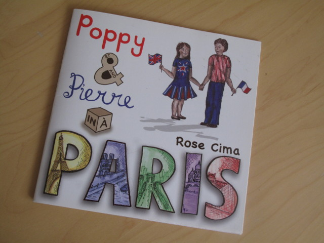 The cover of the bilingual children's book, Poppy and Pierre in Paris.
