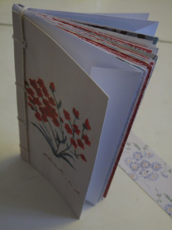Recycled notebook made with old greetings cards