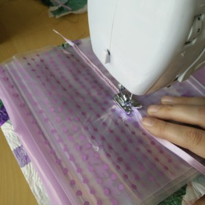 Sewing the plastic bags together