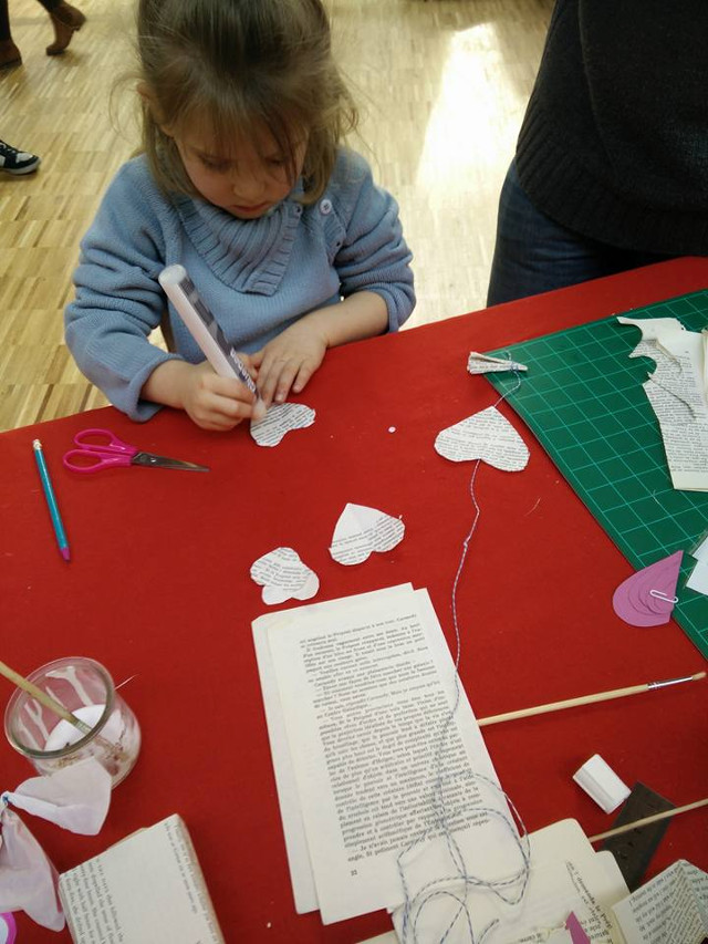 Recycled book craft projects: Making a recycled paper heart garland