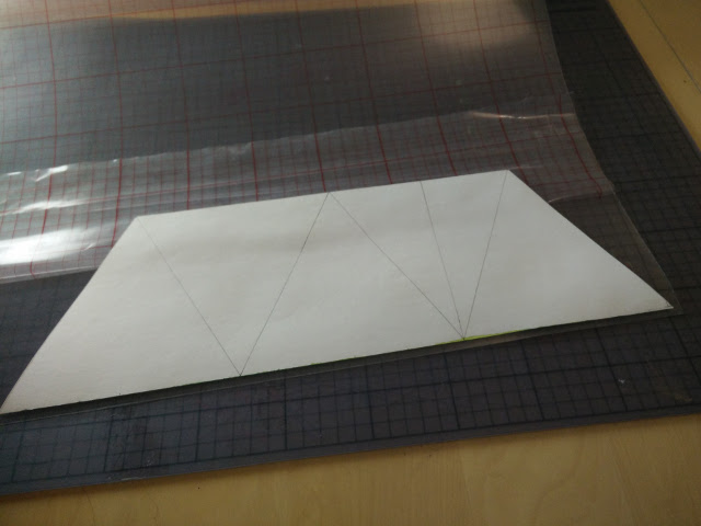 Sticking the styrene to the paper
