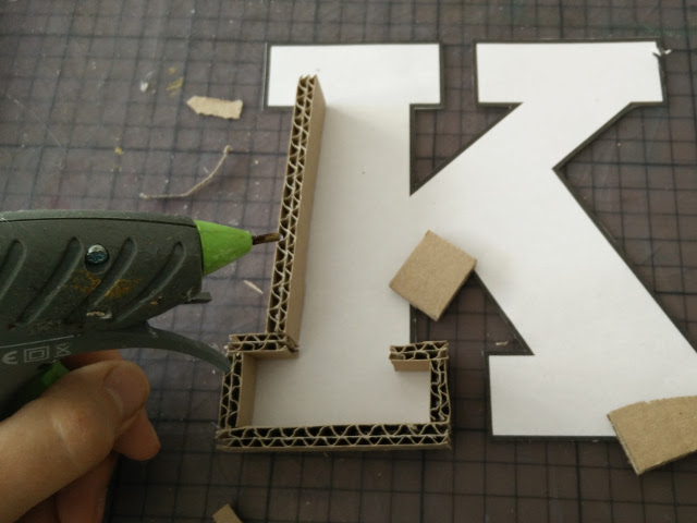 Glue cardboard strips along the outline of the letter