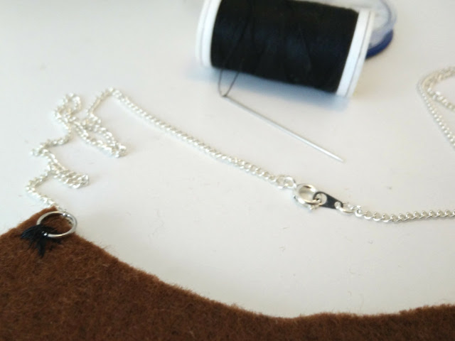Sew chain onto necklace