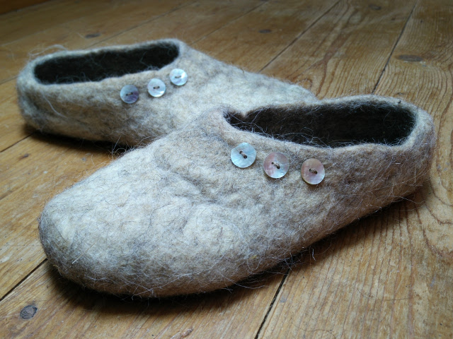 Slippers made with recycled wool insulation