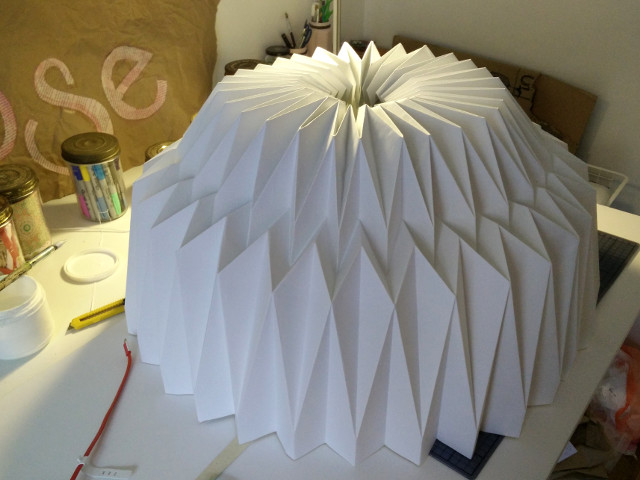 Folded paper base glued together into a tube