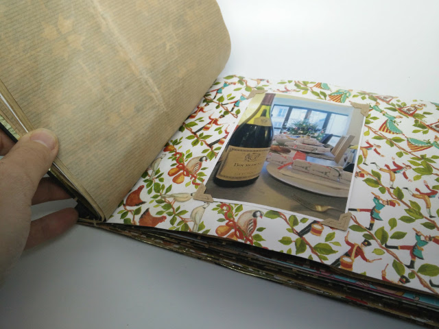 Christmas photo album made from recycled wrapping paper