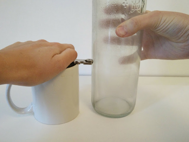 Scoring the glass bottle with a glass cutter
