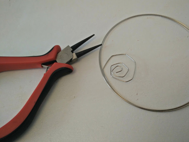 Start by making a wire spiral