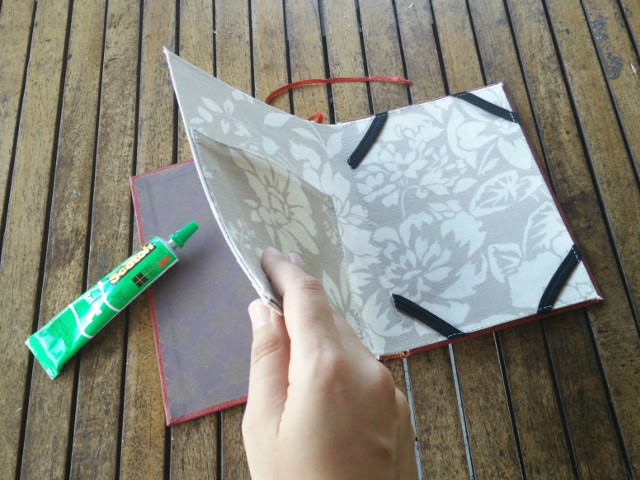 Gluing the card to the book cover