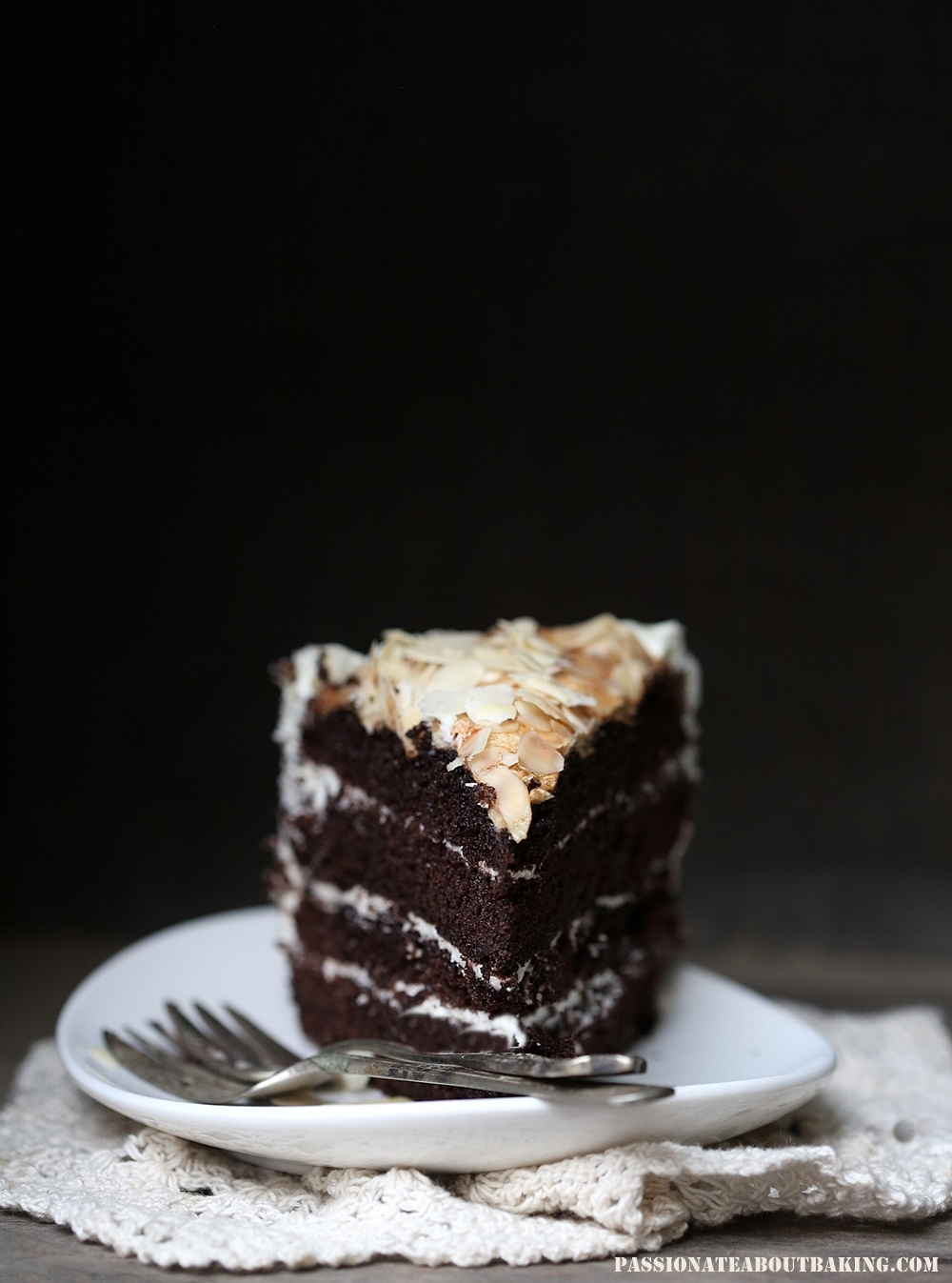 Dark Chocolate Layered Cake with Almond Meringue Topping