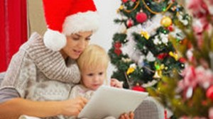 http://www.dreamstime.com/royalty-free-stock-image-mom-baby-using-tablet-pc-near-christmas-tree-image27918386