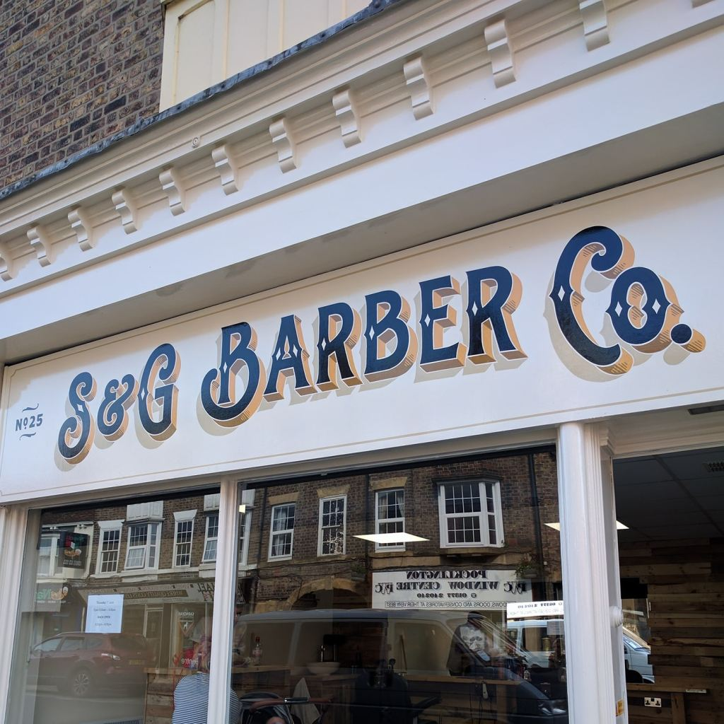 S and G barbers shop hand painted sign