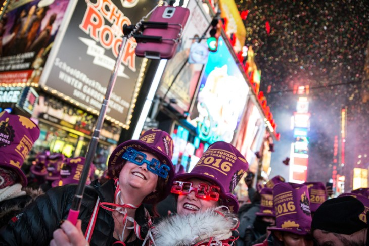 NEW YORK, NY - JANUARY 1:  Women take a selfie to celebrate ringing in the new year in Times Square on January 1, 2016 in New York City. The New York City Police Department deployed more than 6,000 officers in the Times Square area, including more than 1,100 officers who graduated from the police academy on Tuesday.  (Photo by Andrew Burton/Getty Images)