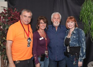 Paul and Barb Vesco backstage with Kenny Rogers and Kris Hall