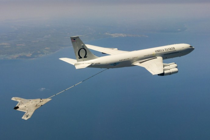 The Navy's unmanned X-47B receives fuel from an Omega K-707 tanker while operating in the Atlantic Test Ranges over the Chesapeake Bay. U.S. Navy photo