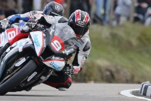 Pacemaker Press, Belfast: 09/06/2015: Ian Hutchinson on the PBM Kawasaki and Guy Martin on the Tyco BMW at the Bungalow during the Royal London 360 Superstock TT race. Picture by Dave Kneen
