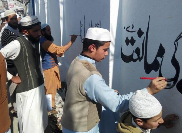 Pupils in Taliban-hit valley turn to sport, pro-peace graffiti