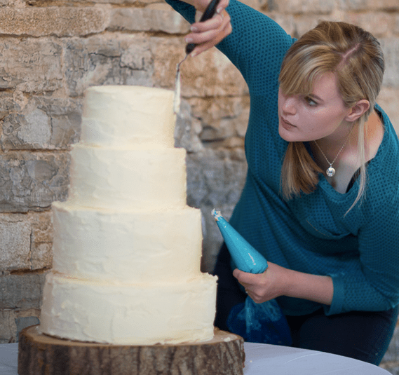 Putting the finishing touches on my sister's cake. Photo by Belinda McCarthy.