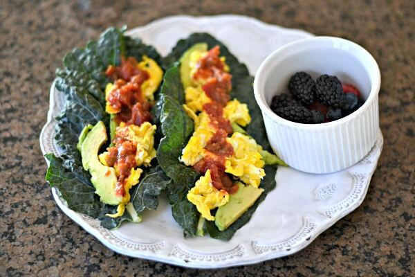 Kale tacos with scrambled eggs, avocado and salsa. Whole30 compliant.